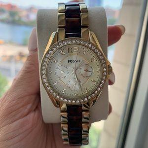 Gold Tortoise fossil watch with diamond rim